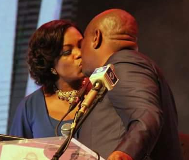 Photo of Rivers state governor, Nyesom Wike and his wife kissing passionately at the #silverbirdmanoftheyearaward