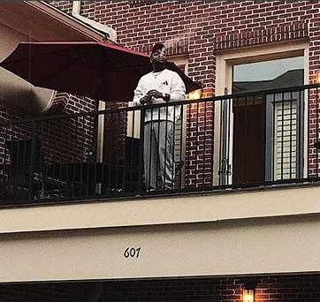 Davido shares a photo of himself at his Atlanta home, with his new Bentley Bentayga super car parked in front of the house