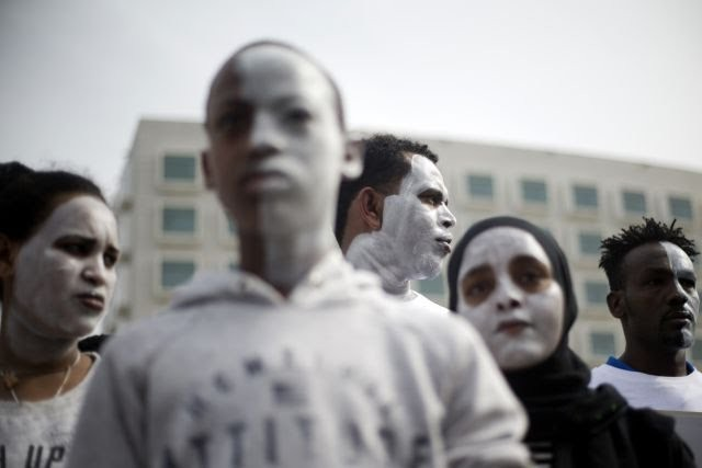 Africans  in Israel paint their faces white to avoid deportation