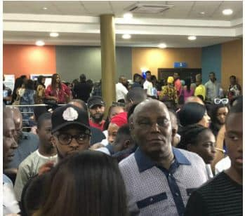 Photos: Atiku Abubakar queues up to buy ticket to watch Black Panther at the cinema in Abuja