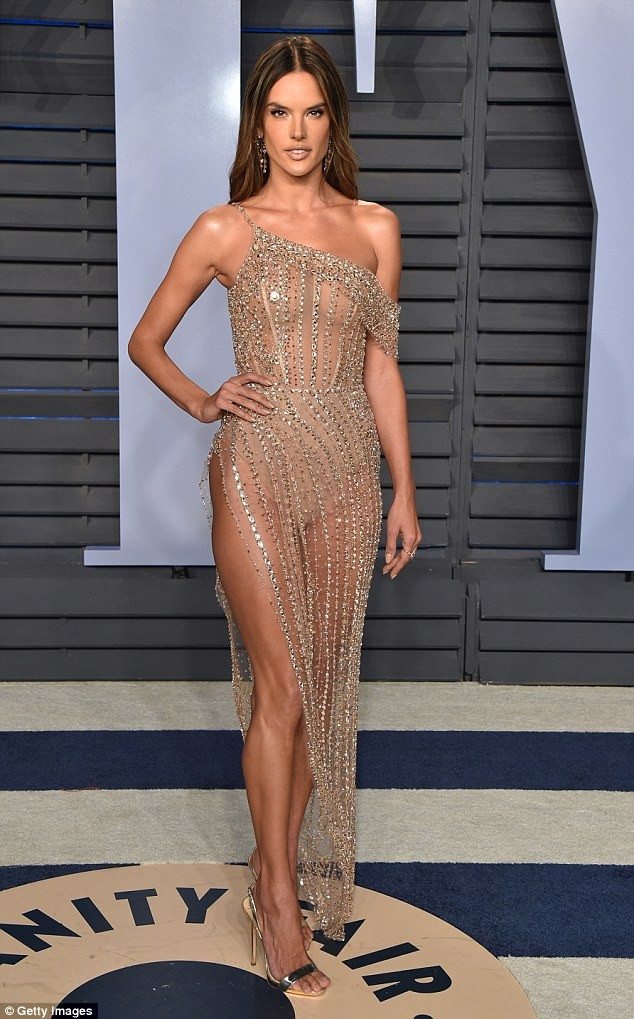 Photos: Braless Alessandra Ambrosio shows off her peachy posterior and sexy legs in sheer nude-colored dress for Vanity Fair Oscar Party?