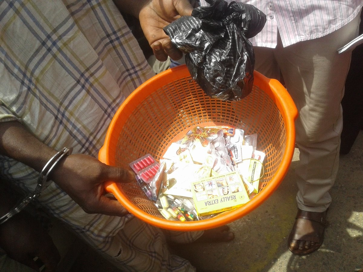 Police nabs father and son selling Tramadol and other hard drugs to school pupils in Lagos (photos)