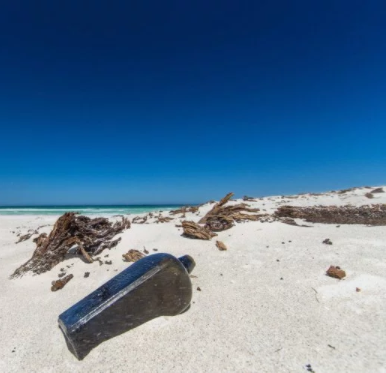 World?s oldest message in a bottle (from 1886) found half-buried in beach (photos)