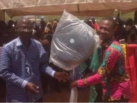 Photo: Ghanaian teacher who walks 42km to class everyday rewarded with standing fan for his ?well-dedicated service?