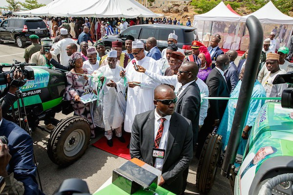 Photos: Presidnet Buhari drives tractor as he launches Plateau State Tractor Ownership Scheme