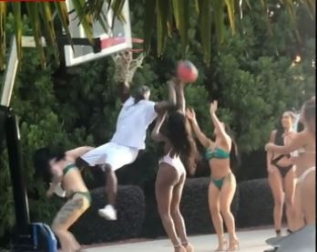 Akon spotted playing basketball with hot bikini-clad women in new video