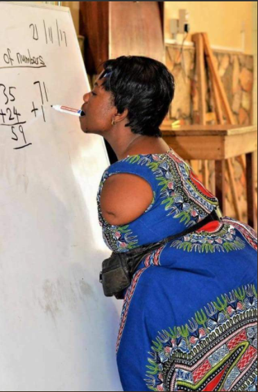 Beautiful armless Ghanaian mathematics teacher who uses her mouth to write goes viral