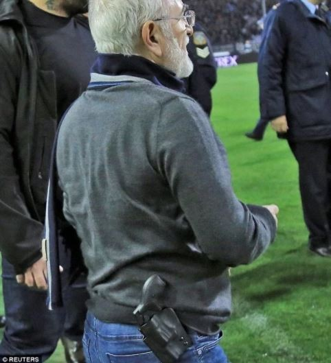 Update: Greek football club president apologizes for invading & confronting referee with a gun on the pitch