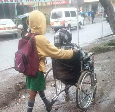 Heartwarming photos of a young Kenyan boy who takes his disabled mother to work everyday before proceeding to school