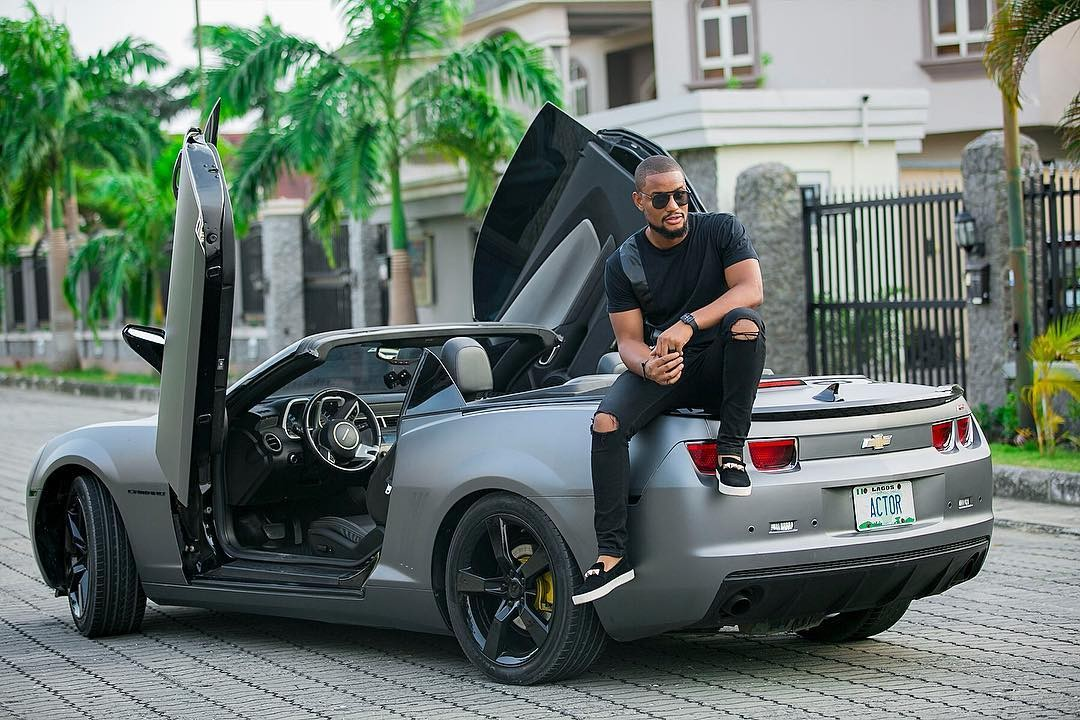Alex Ekubo and his cool car strike a pose