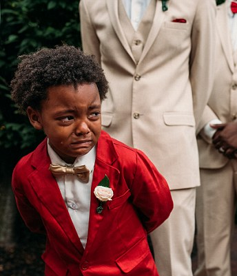 Awww... Boy, 6, cries uncontrollably as his mother walks down the aisle on her wedding day
