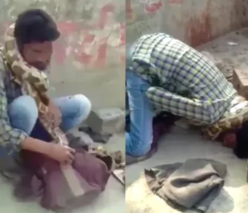 Snake charmer gets strangled by his pet python while performing a live show (video)