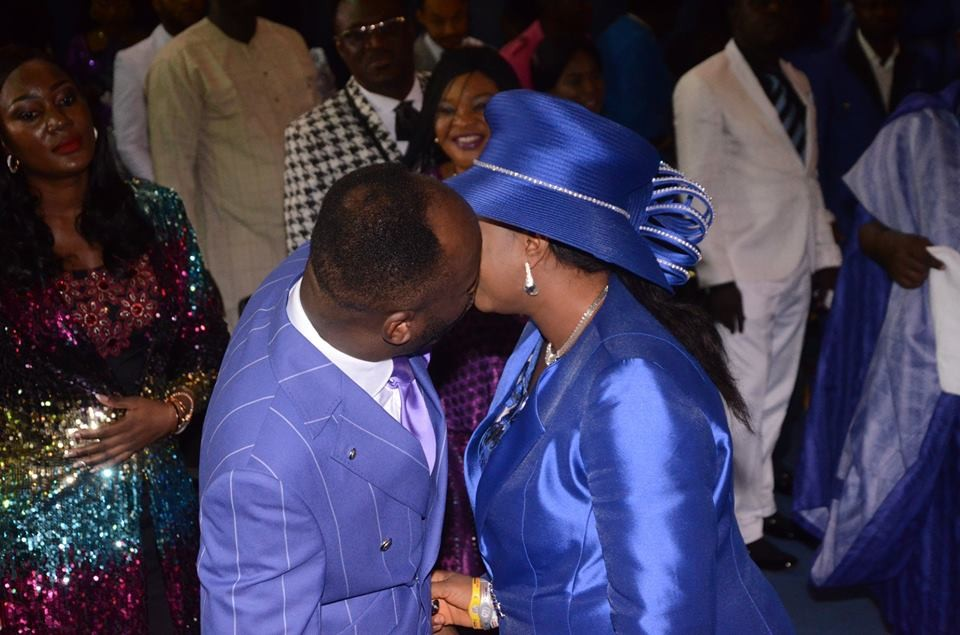 Lovely photo of clergyman, Apostle Suleman giving his wife, Lizzy, a holy kiss at his birthday celebration