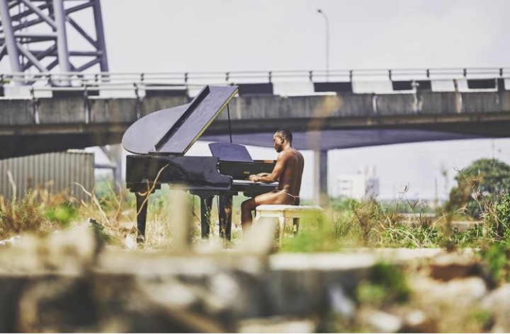 Singer, Brymo shares a photo of himself playing the piano naked