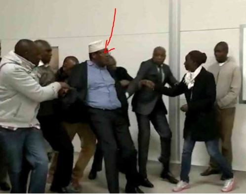Hilarious photo of a Kenyan opposition politician being detained in an airport toilet