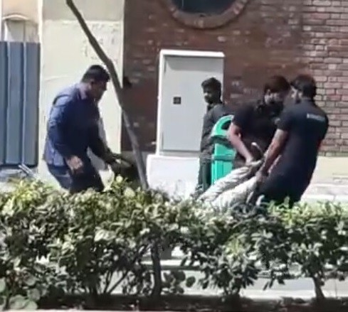 Photos/Videos: Outrage over clips of an African student being manhandled by University security guards in India