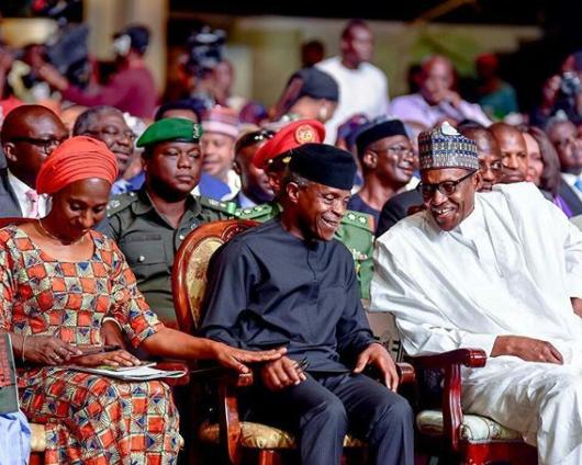 Caption this photo of President Buhari, Yemi Osinbajo and his wife