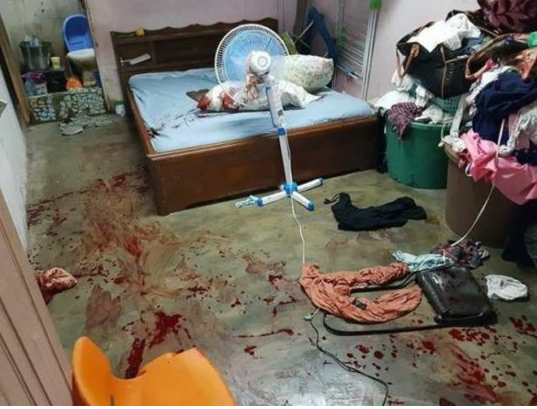 Graphic Photos: Wife kills husband who is a military man?in his sleep for having a baby with another woman