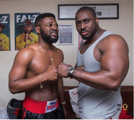 Caption this photo of Falz and a popular UK bodyguard