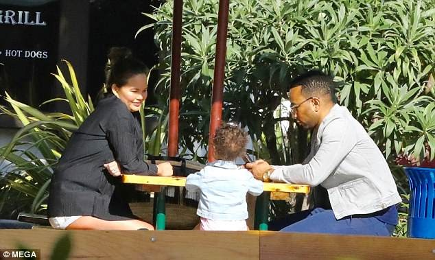 Pregnant Chrissy Teigan flaunts baby bump in sheer top and hotpants for lunch date with her husband John Legend and daughter Luna (Photos)