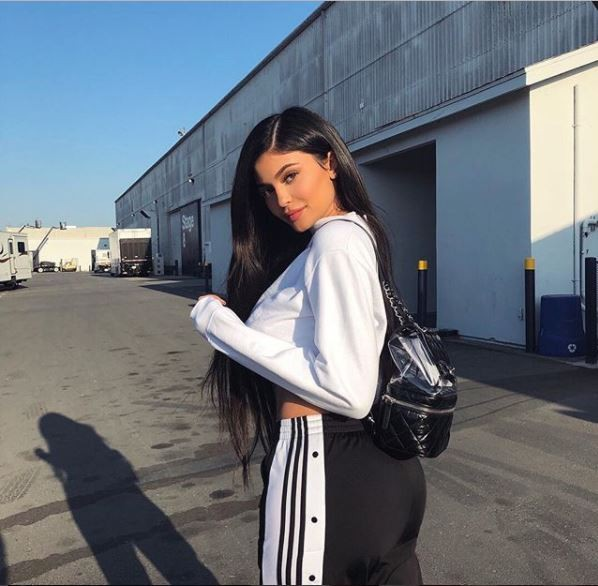 Kylie Jenner shows off her flat tummy and curves two months after giving birth to daughter Stormi Webster (Photos)