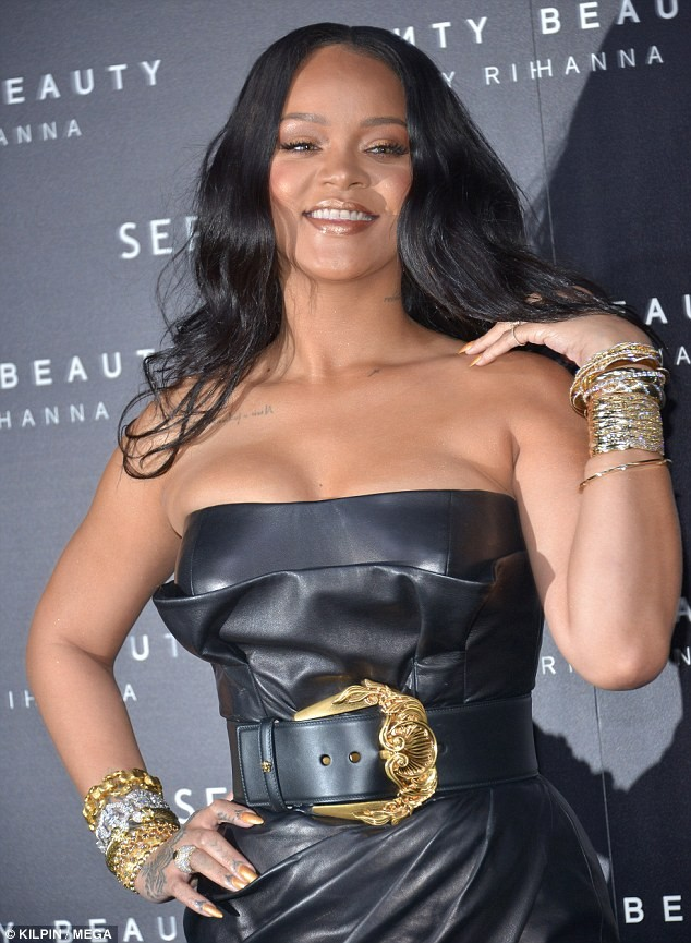 Rihanna rocks tiny strapless mini-dress as she launches latest Fenty Beauty line in Milan (Photos)