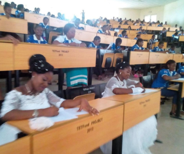 Viral photos of two Benue State University students writing?exams in wedding gowns