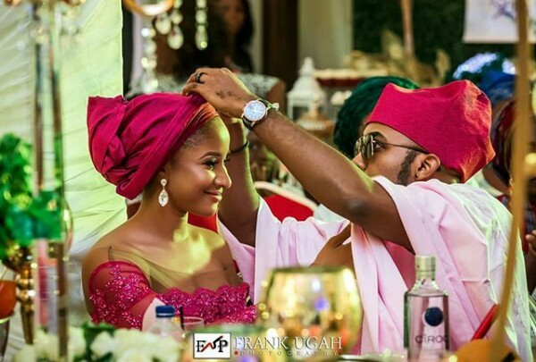Photos: Caught in the act! Photographer captures BankyW adjusting Adesua