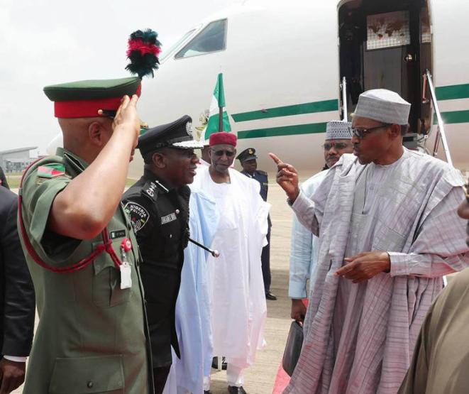 Caption this photo of President Buhari and Police IG, Ibrahim Idris