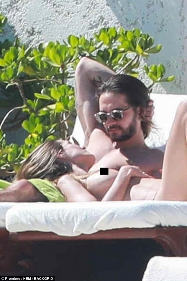 Heidi Klum, 44 goes topless as she passionately kisses her 28-year-old beau in Mexico (Photos)