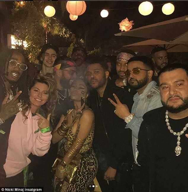 Nicki Minaj flaunts her ample assets in revealing leopard-print bodysuit at TAO x Puma Coachella party (Photos)