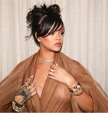 Rihanna bares her boobs in see-through outfit and Don Jazzy can