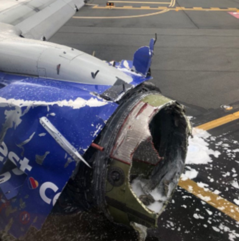 Flight Horror! One dead,?woman almost sucked out of a plane window after engine exploded at?32,000ft (Photos)
