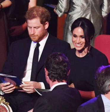Meghan Markle and Prince Harry in matching blue as they join other Royals for the Queen