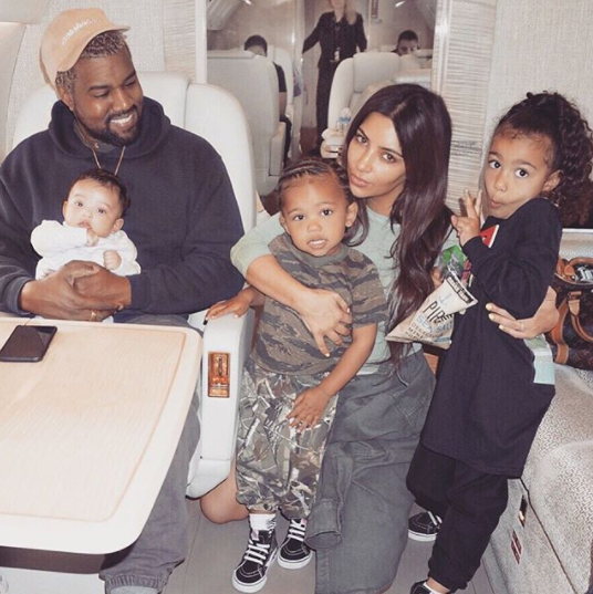 Kim Kardashian shares adorable photo of herself, Kanye and their three kids inside a private jet