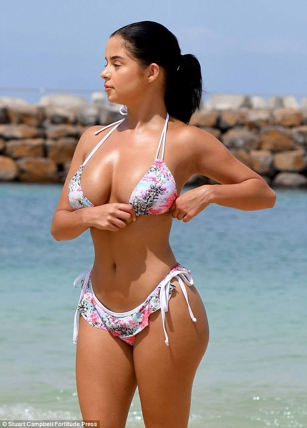 Demi Rose puts on an eye-popping display in skimpy floral bikini in Cape Verde (Photos)