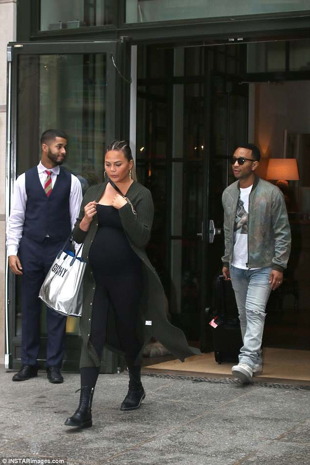 Chrissy Teigen flaunts her baby bump in black ensemble as she leaves a New York hotel with John Legend (Photos)