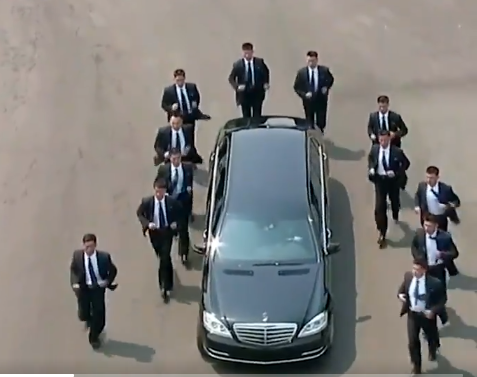 This video of?Kim Jong Un? driving off and his 12 bodyguards?running beside the vehicle is the best thing you