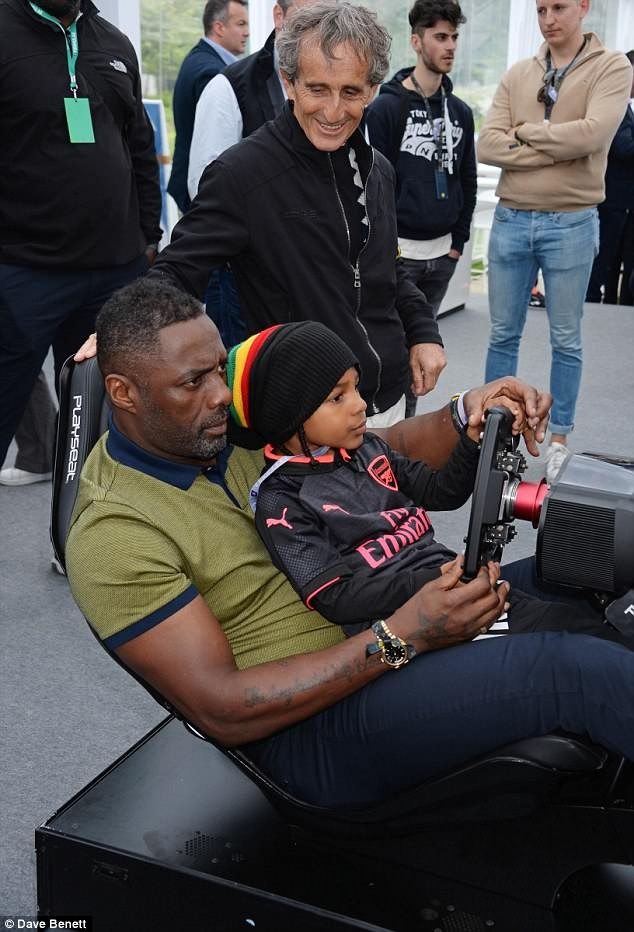 Idris Elba enjoys family day out with fianc?e Sabrina Dhowre and his children at Formula E event in Paris (Photos)