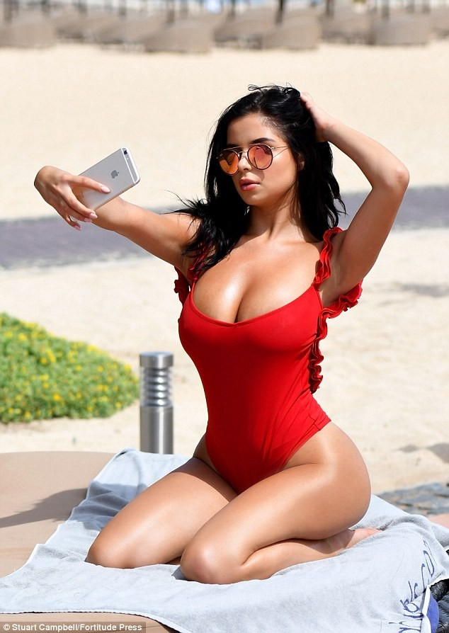 Demi Rose parades her ample assets in skimpy swimsuit