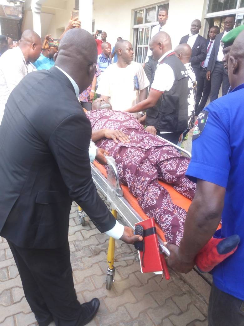 Photos of Dino Melaye being brought into the court on a stretcher, re-arrested by the police after granted bail
