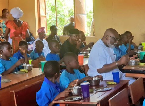 Image result for VP Yemi Osinbajo pictured having lunch with students of a public school in Ondo