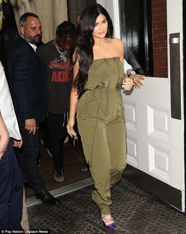 Kylie Jenner flaunts her incredible post-baby body in strapless jumpsuit as she steps out with Travis Scott in NYC (Photos)