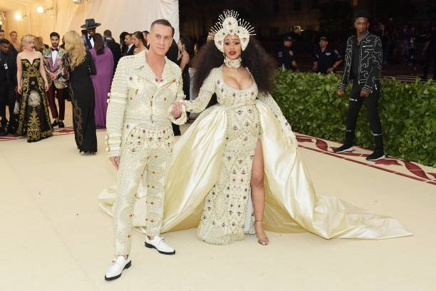 Cardi B flaunts her baby bump in a gem-encrusted Moschino gown at MET Gala