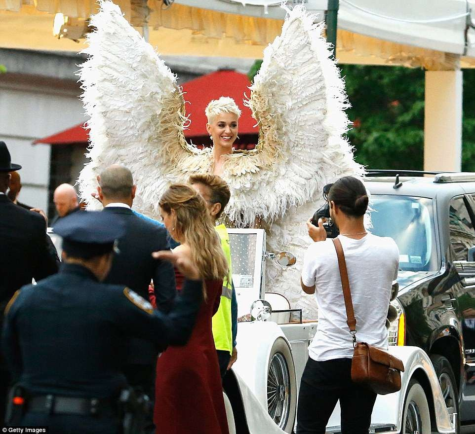 Katy Perry rode in a vintage covertible to the Met Gala as her feathered wings were too high and wide