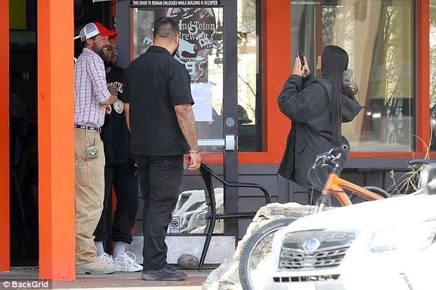 Kanye West all smiles as Kim Kardashian visits him in Wyoming (Photos)