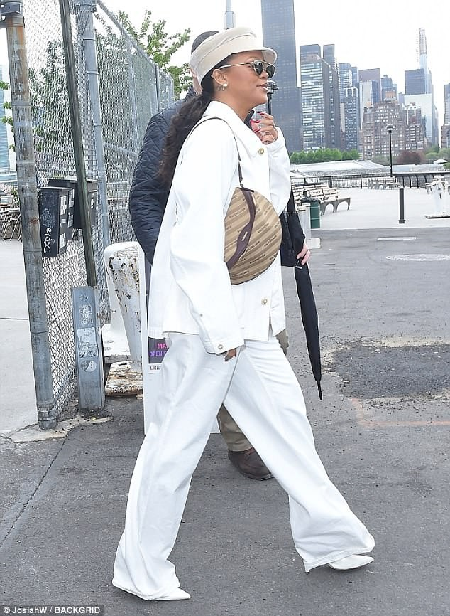 Rihanna stuns in an all-white ensemble as steps out in NYC?