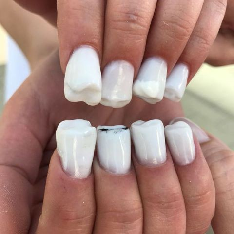 Oh boy! Is this teeth nail art going to become a trend?