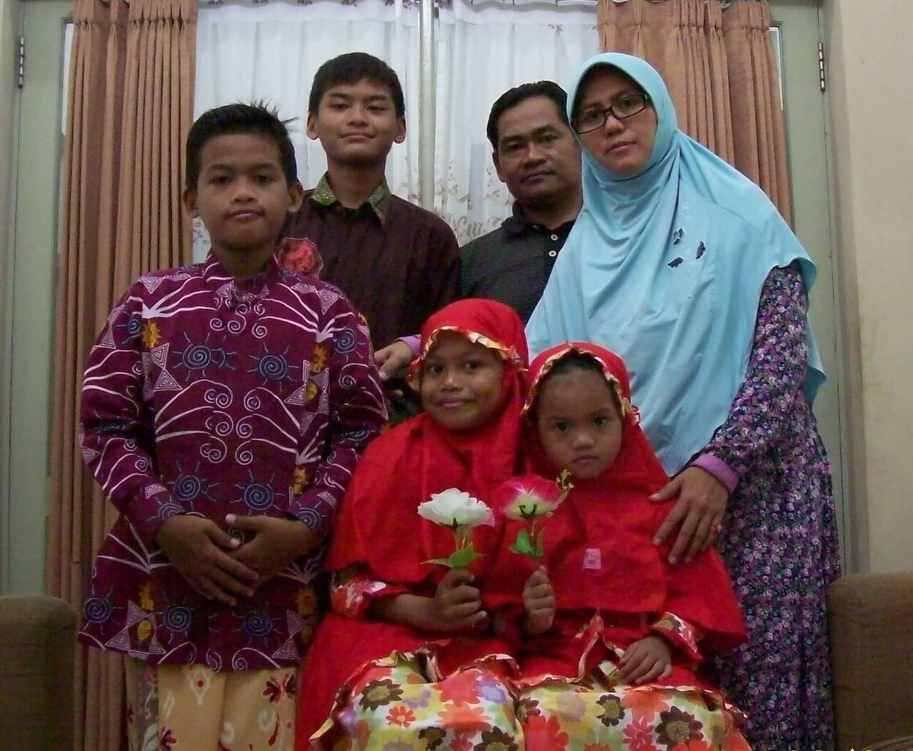 Face of Terror: Photo of the family of six that launched deadly suicide attacks on three churches in Indonesia