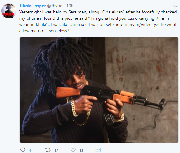 Nigerian artist Jhybo detained by SARS officers after a photo of him holding a rifle was found on his phone